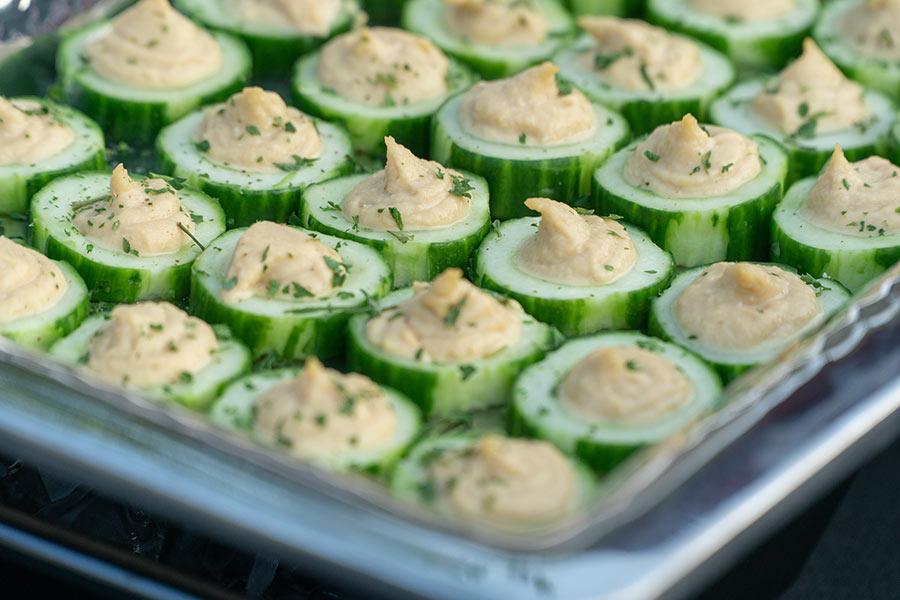 sunset social photo of cucumber hummus platter from the hilton garden inn