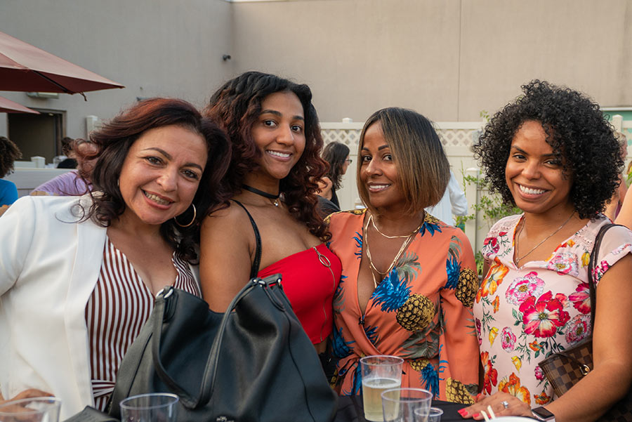 sunset social photo of four women attendees