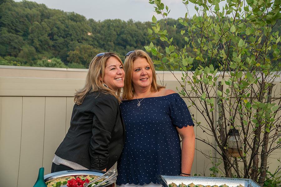 sunset social photo of hilton garden inn representatives