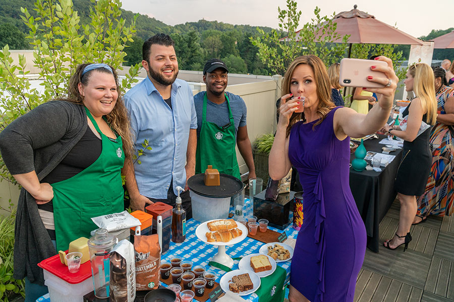 sunset social photo of starbucks employees with lisa