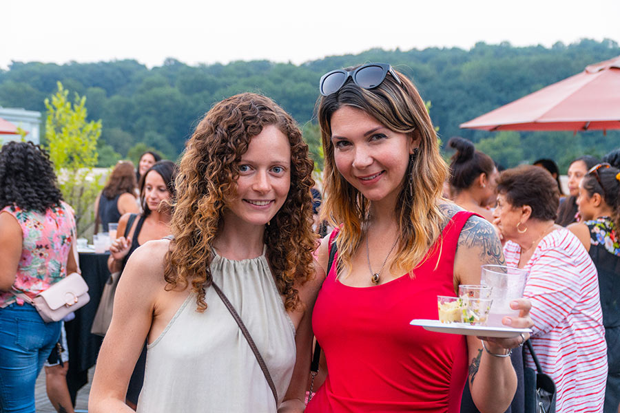 sunset social photo of two woman attending